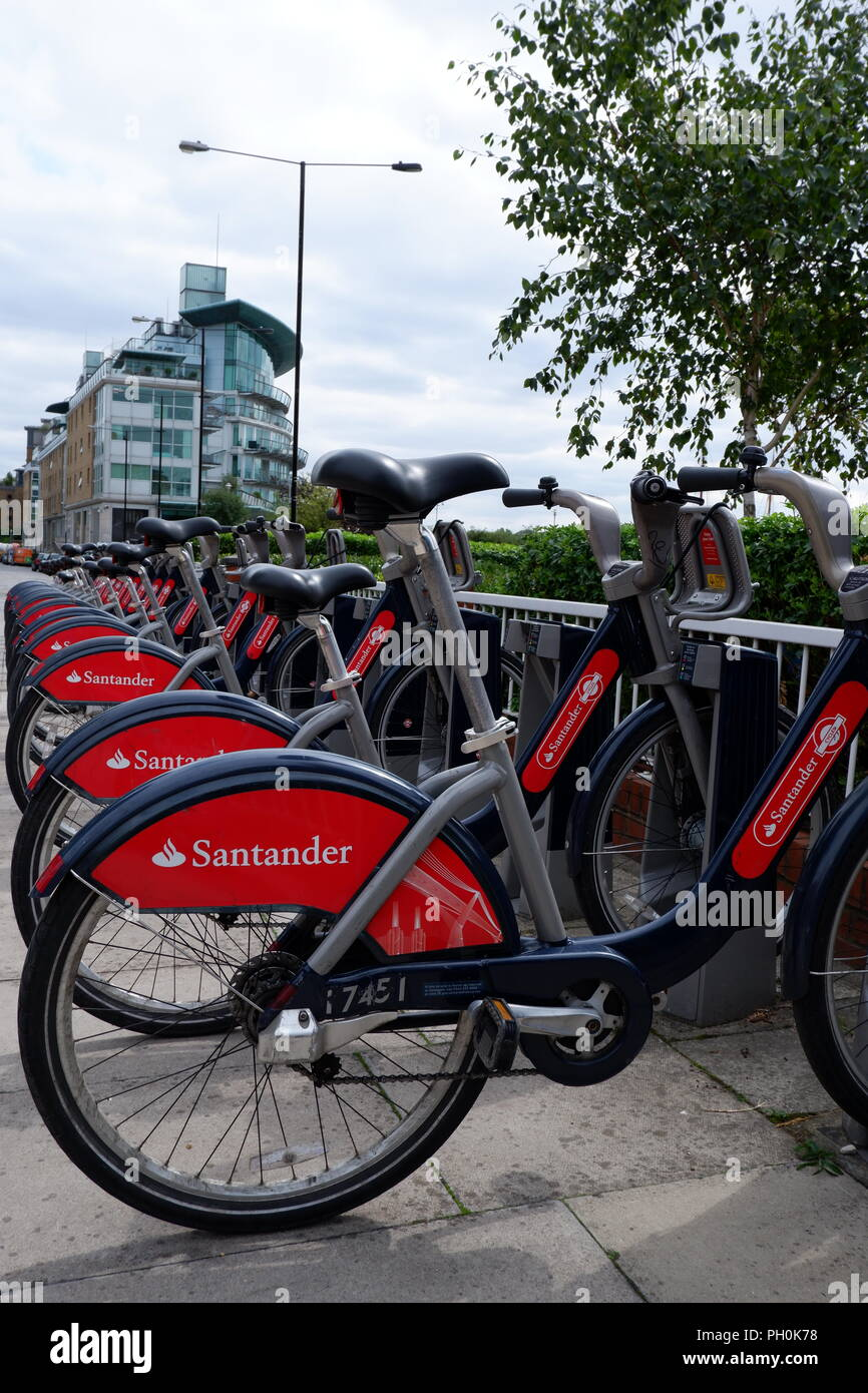 A docking station containing TFL bicycles in Wapping, East London.  The bicycles are sponsored by Santander and are commonly known as Boris Bikes. - Stock Image
