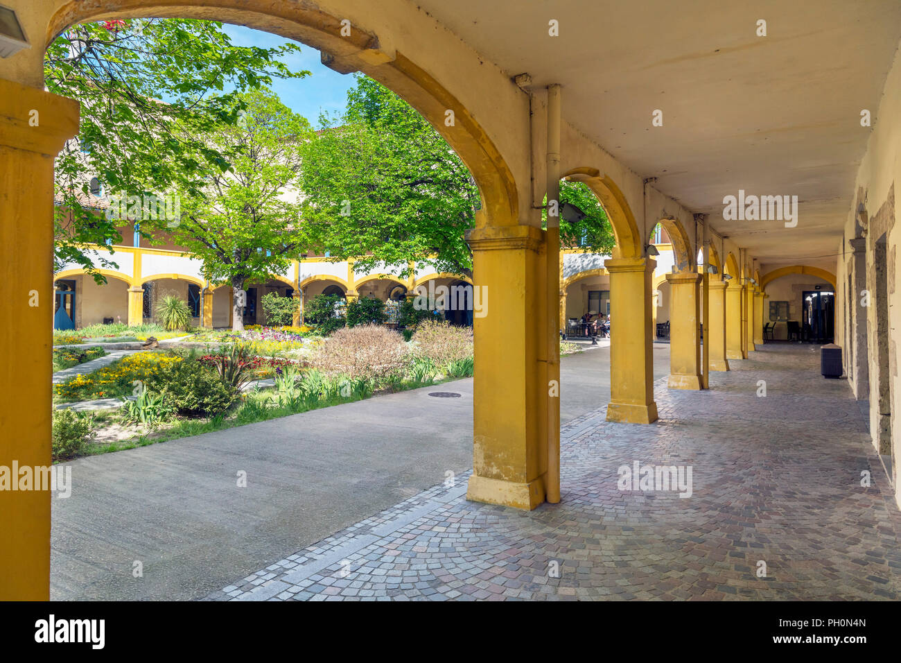 Portico in the courtyard of the Hospital at Arles, now called l'Espace Van Gogh, Arles, Provence, France - Stock Image