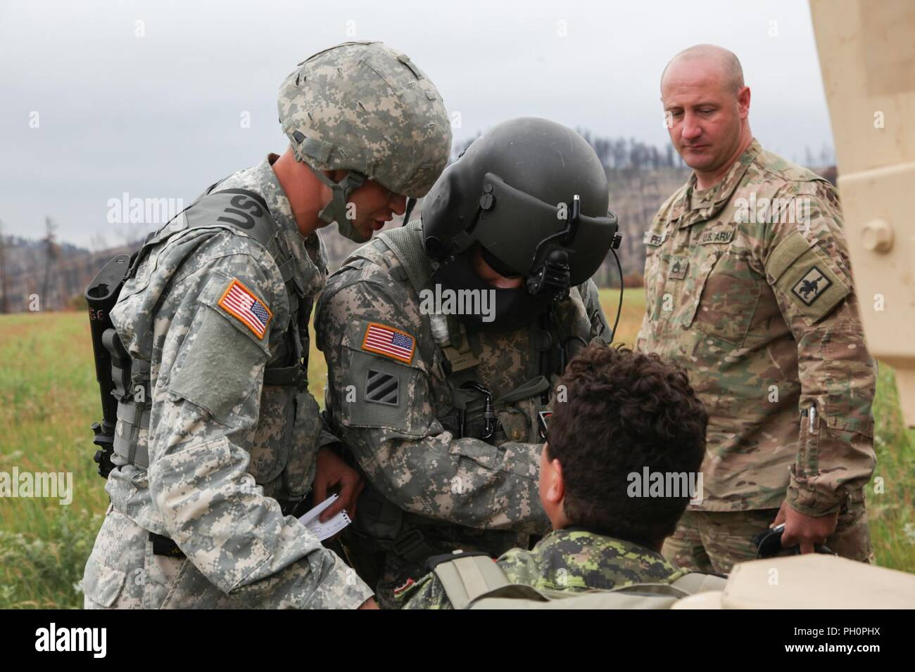 U S  Soldiers with the Army National Guard, assess a