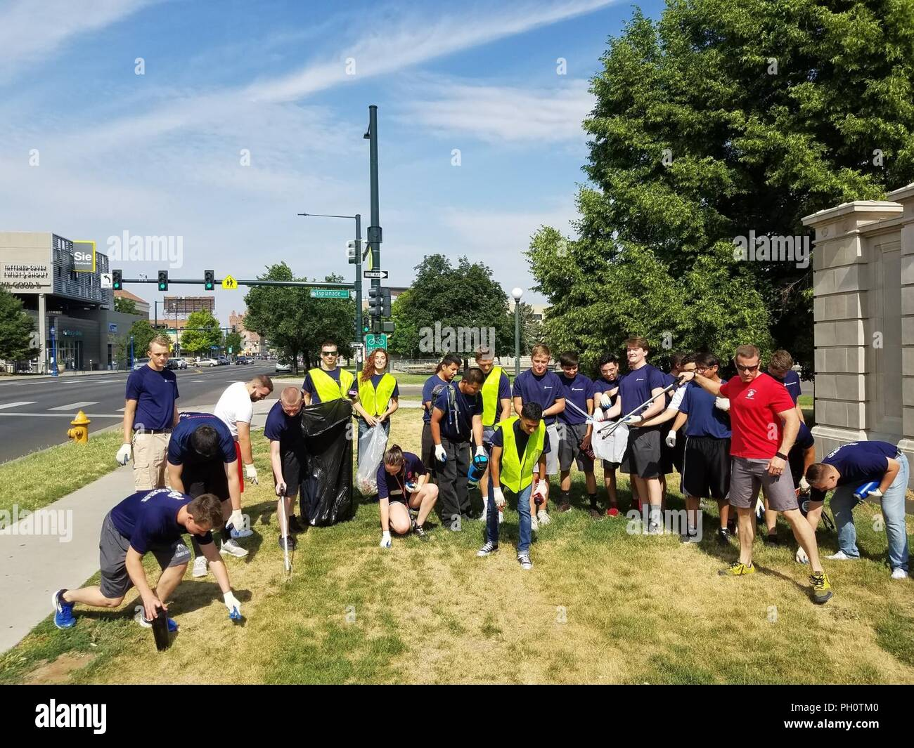 Local Marines and future Marines with Recruiting Sub-Stations Metro West and Metro North pick up trash and debris during an Adopt a Spot cleanup event June 16, 2018. The local Marine Corps recruiting sub-stations have agreed to coordinate monthly cleanups along a section of Colfax Street in Denver, Colorado. - Stock Image