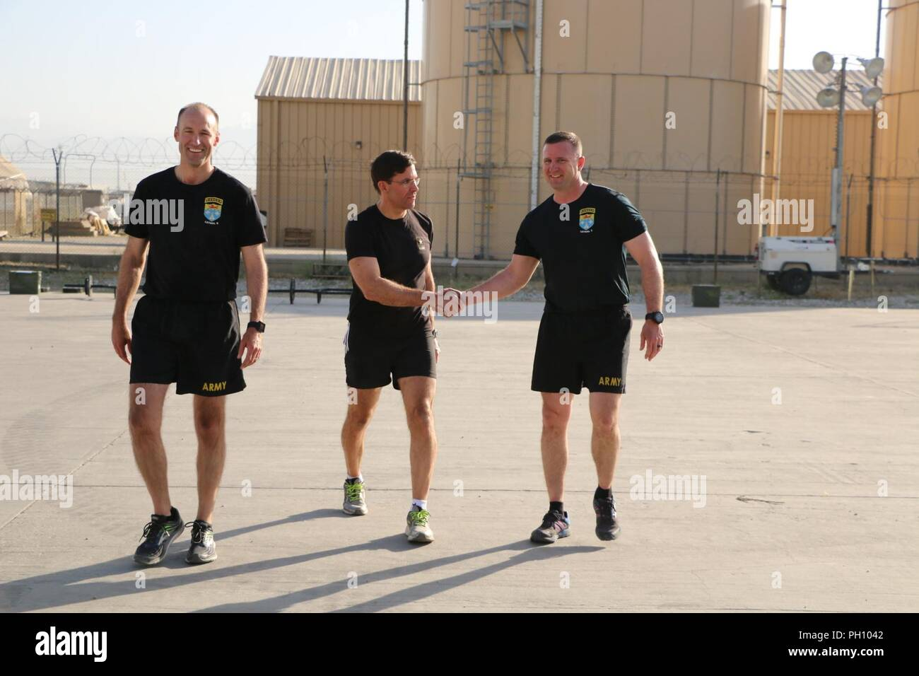 Secretary of the Army Dr  Mark T  Esper (center) greets
