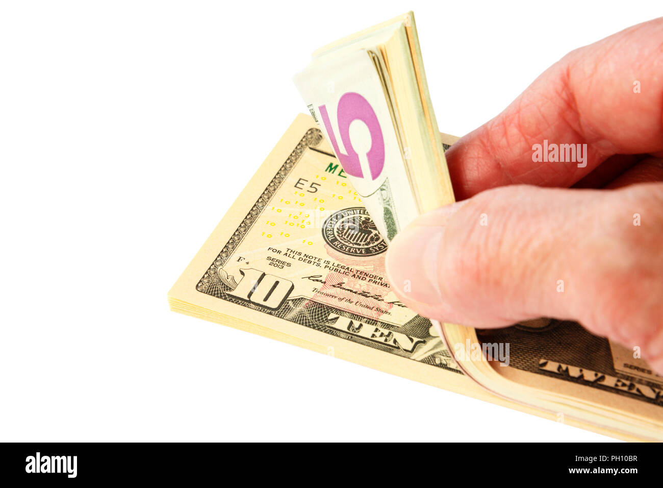 A senior female person's hand counting a pile wodge of American currency money in US dollars dollar bills notes isolated on a white background. USA - Stock Image