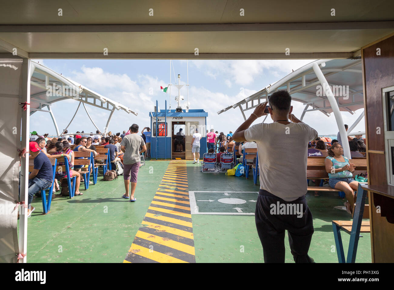 ISLA MUJERES, QR, MEXICO - FEB 11, 2018: The crowded deck of a ferry heading to Isla Mujeres. - Stock Image