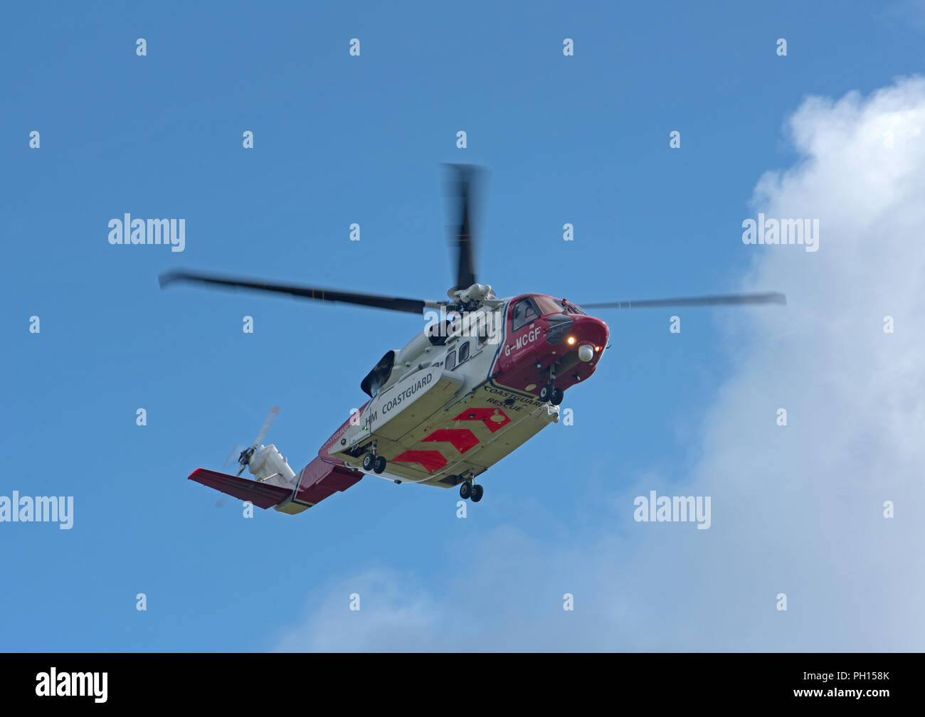 The Inverness based car Coastguiard Helicopter departs its home base to attend a rescue mission in the Cairngorms to look for missing persons. - Stock Image