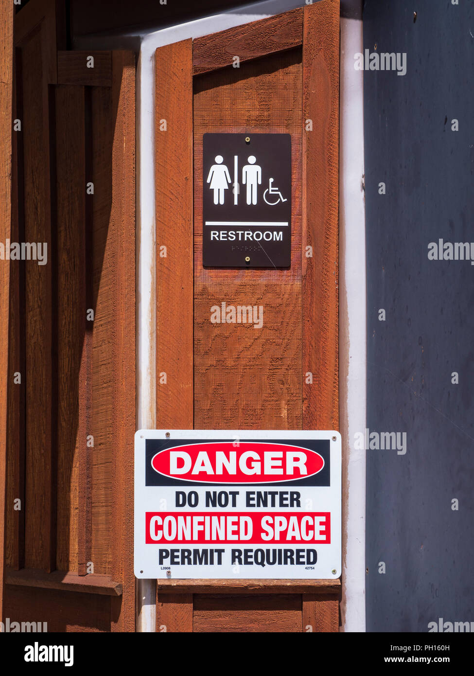 Danger Do Not Enter Confined Space warning on pit toilet, Hornbek Homestead, Florissant Fossil Beds National Monument, Florissant, Colorado - Stock Image