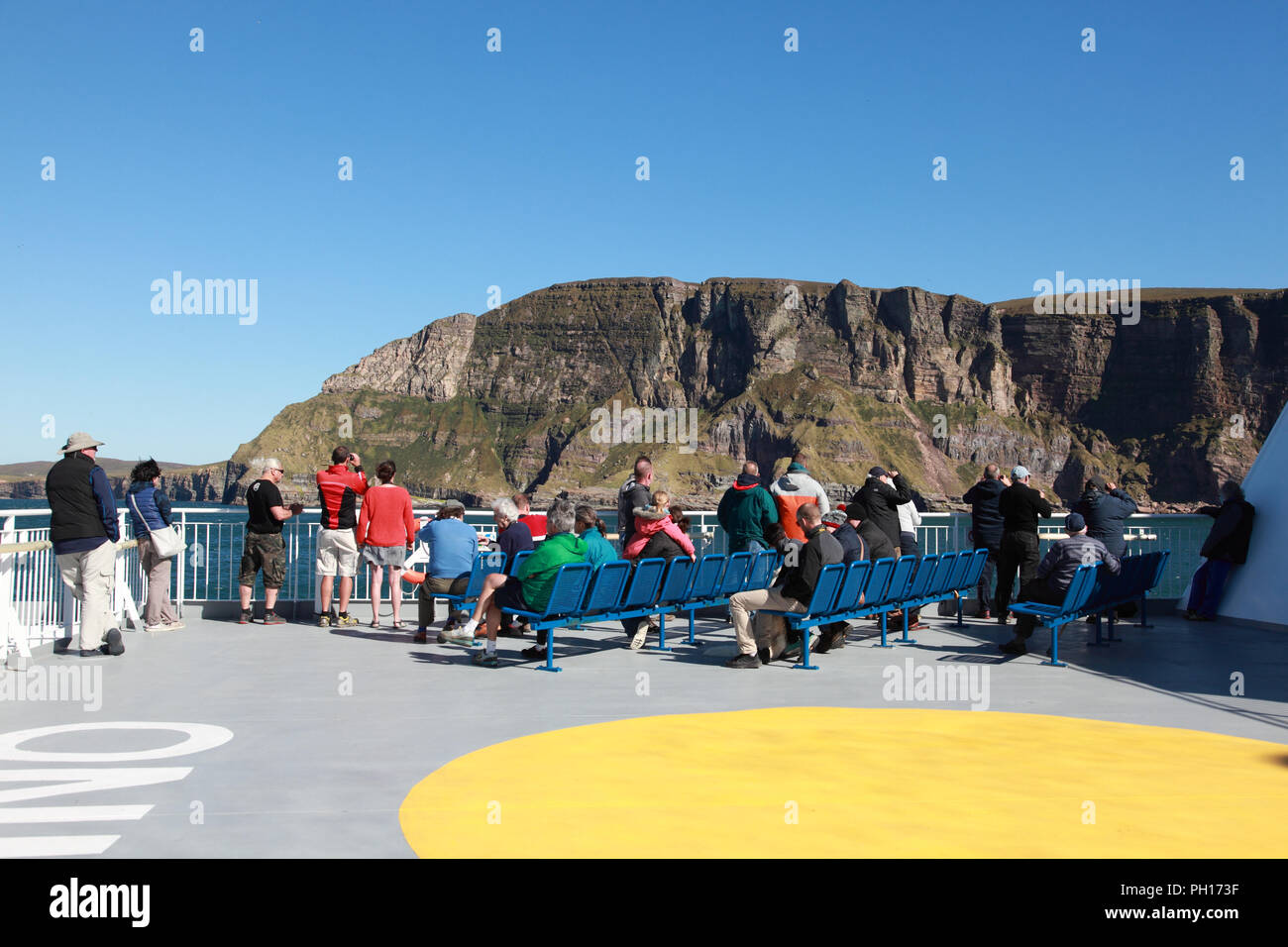 The Northlink ferry MV Hamnavoe passing the cliffs of St John's Head on Hoy, Orkney, Scotland - Stock Image