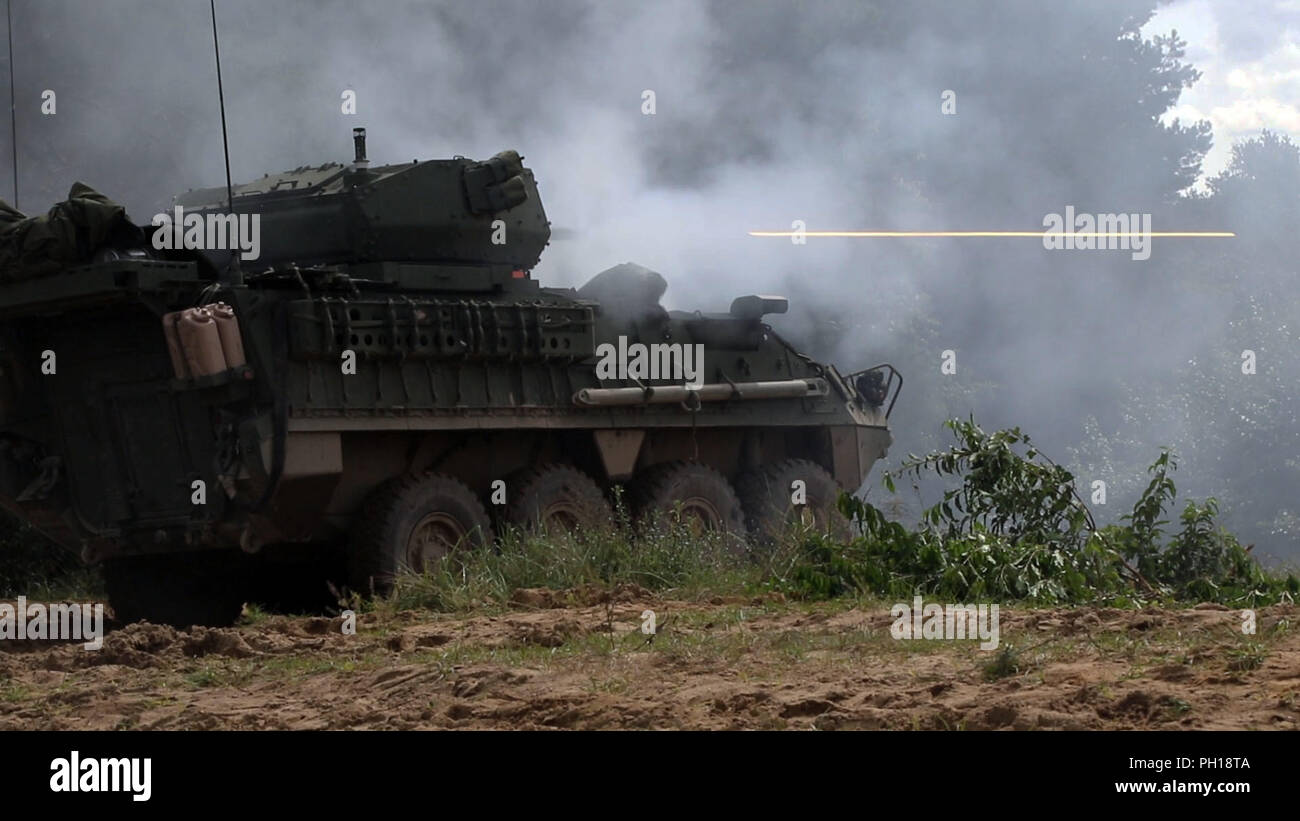 Infantrymen with the 1st Squadron, 2nd Cavalry Regiment fire a Stryker 30mm Infantry Carrier Vehicle – Dragoon (ICVD) during a joint combined arms live fire exercise Aug. 26-30 at Bemowo Piskie Training Area, Poland. 1-2 Cav. Regt. became the first squadron in the U.S. Army to field the newly upgraded dragoon strykers. The CALFEX is designed to maintain readiness and build interoperability among BPTA Soldiers. The Soldiers are on a six-month rotational assignment in support of the multinational battle group comprised of U.S., U.K., Croatian and Romanian Soldiers who serve with the Polish 15th  Stock Photo