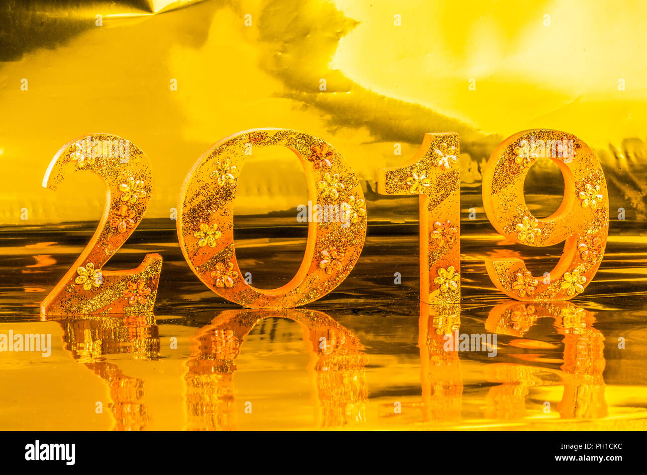 Happy new year 2019 is made in gold color place in golden - Lucky color for new year 2019 ...