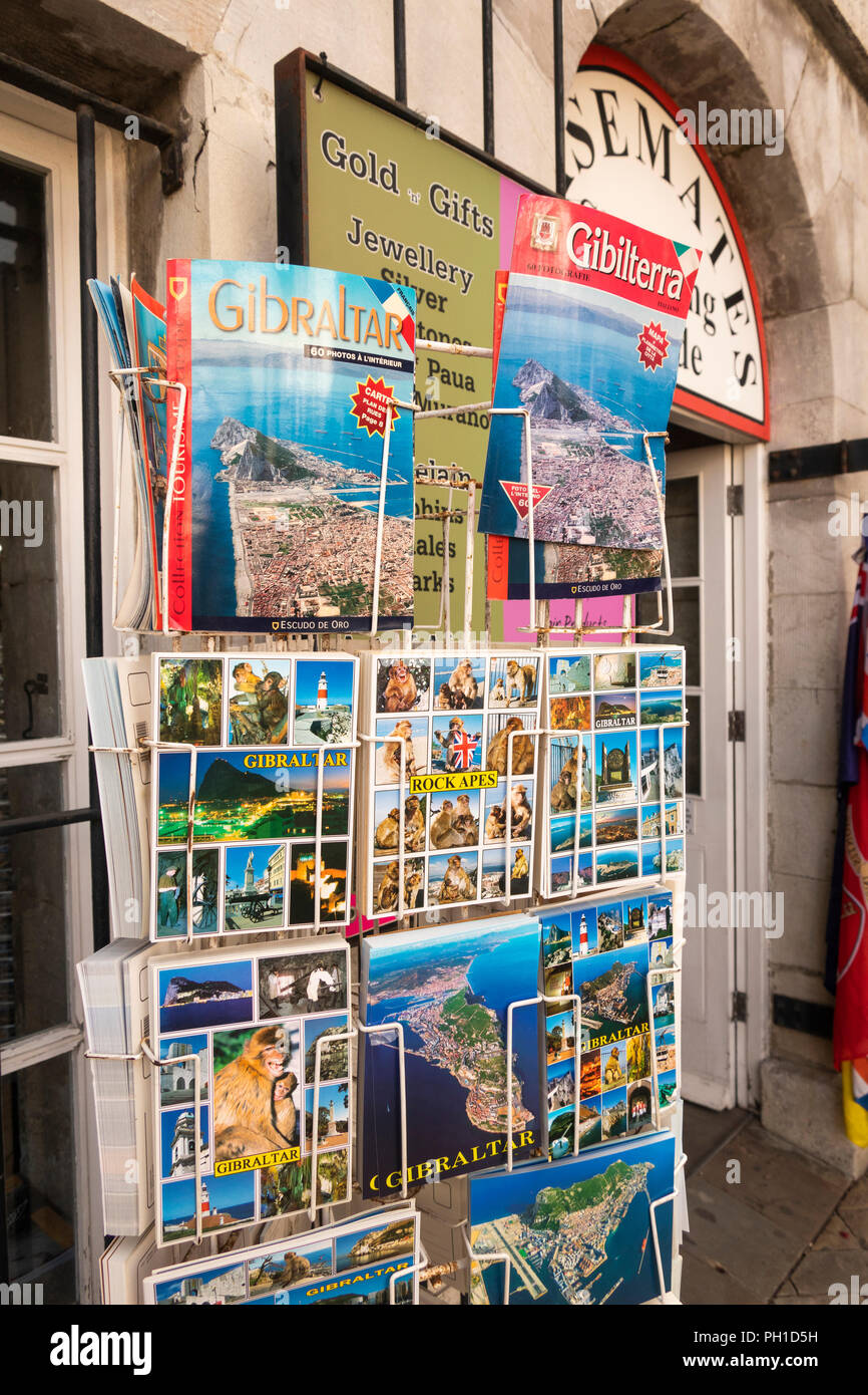 Gibraltar, Main Street, tourist souvenir shop, stand of guide books, maps and postcards - Stock Image