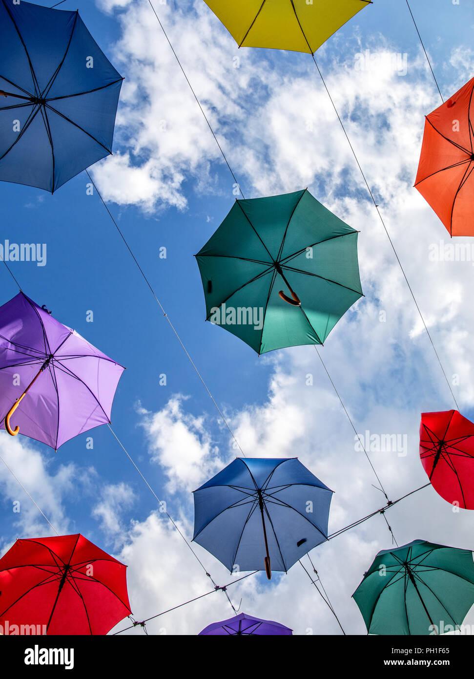 Multi Colored Umbrellas Salisbury Wiltshire UK - Stock Image