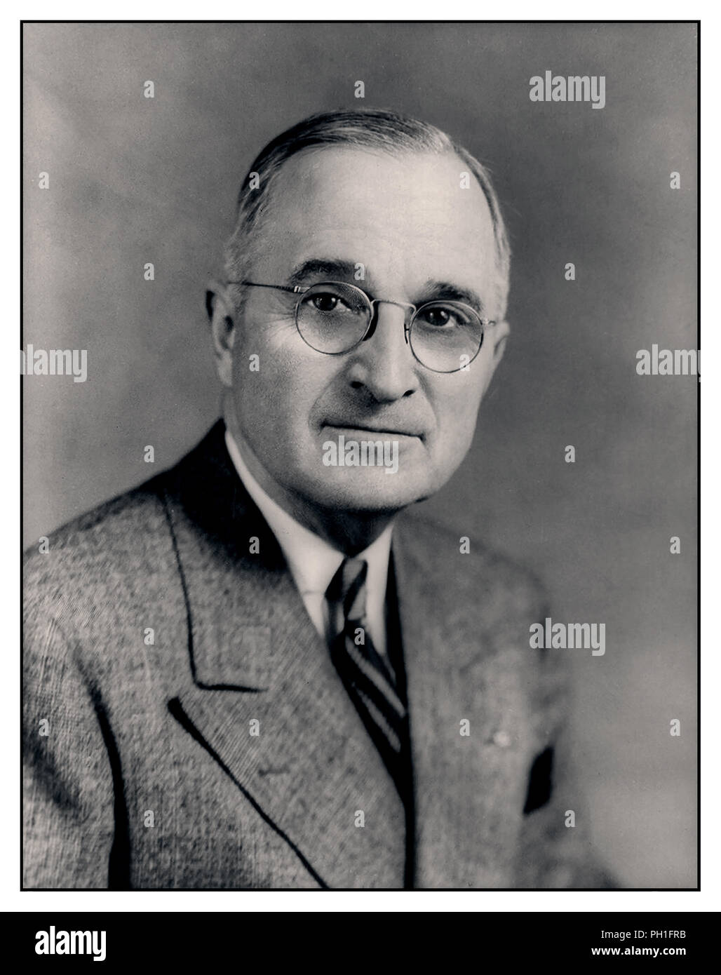 Vintage formal portrait of Democrat Harry S. Truman the 33rd President of the United States, taking office upon the death of Franklin D. Roosevelt. A World War I veteran, he assumed the presidency during the waning months of World War II and the beginning of the Cold War. - Stock Image