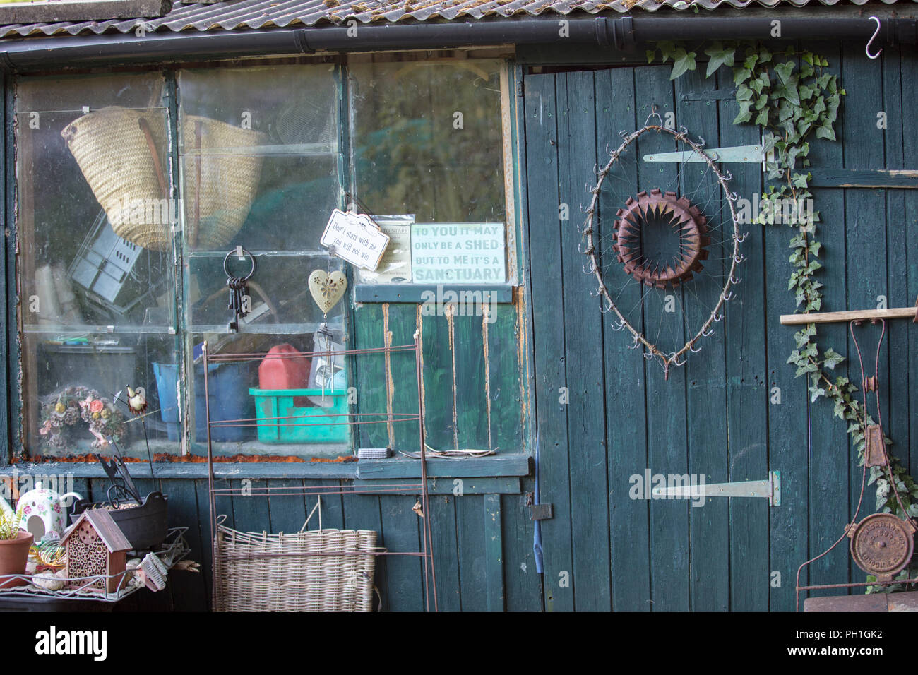 Shed on allotment Mill Hill, London, UK, with interesting and creative artefacts artifacts  and other objects, to be physical active and outside. - Stock Image