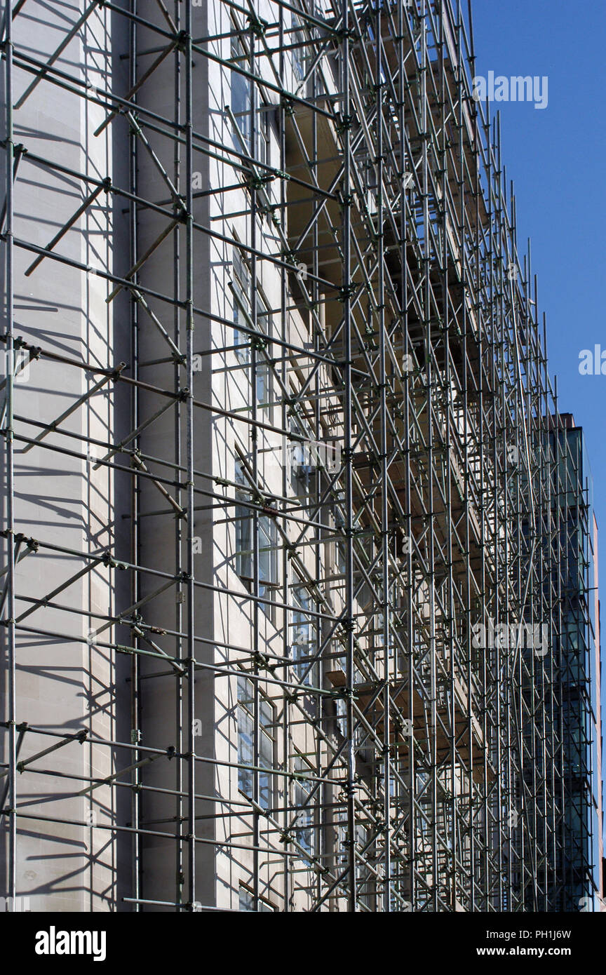 Construction Building site Erected scaffold tight against a building wall in City area of London, England - Stock Image