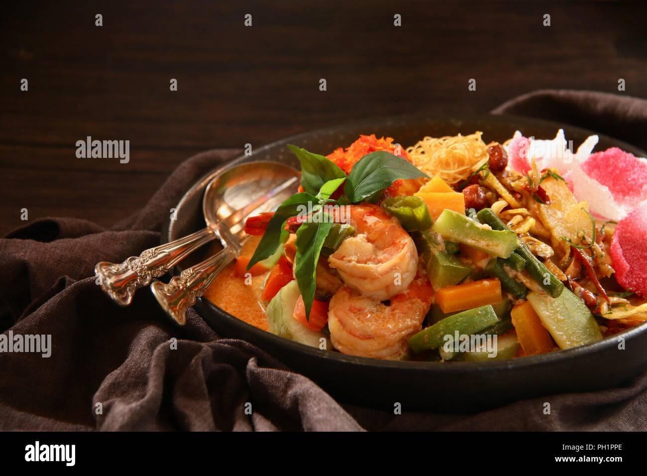 Lontong Medan, the Traditional Rice Cake Soup from Medan, North Sumatra - Stock Image