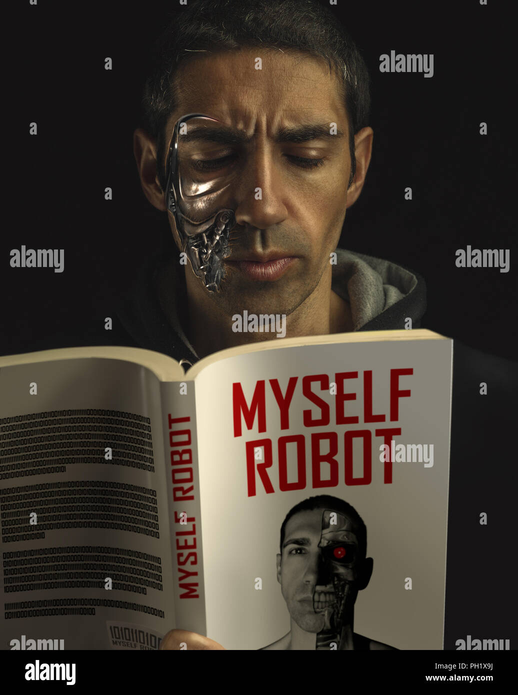 Robot man reading a Science Fiction book about himself. - Stock Image