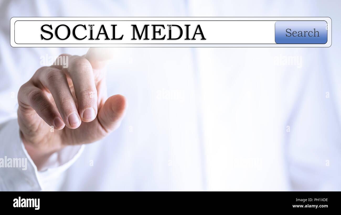 Social media in search box on virtual screen. - Stock Image