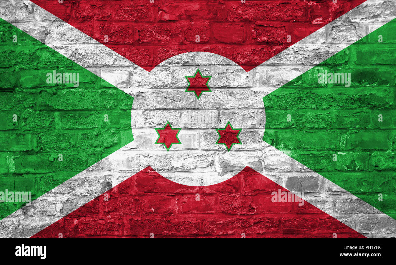 Flag of Burundi over an old brick wall background, surface - Stock Image