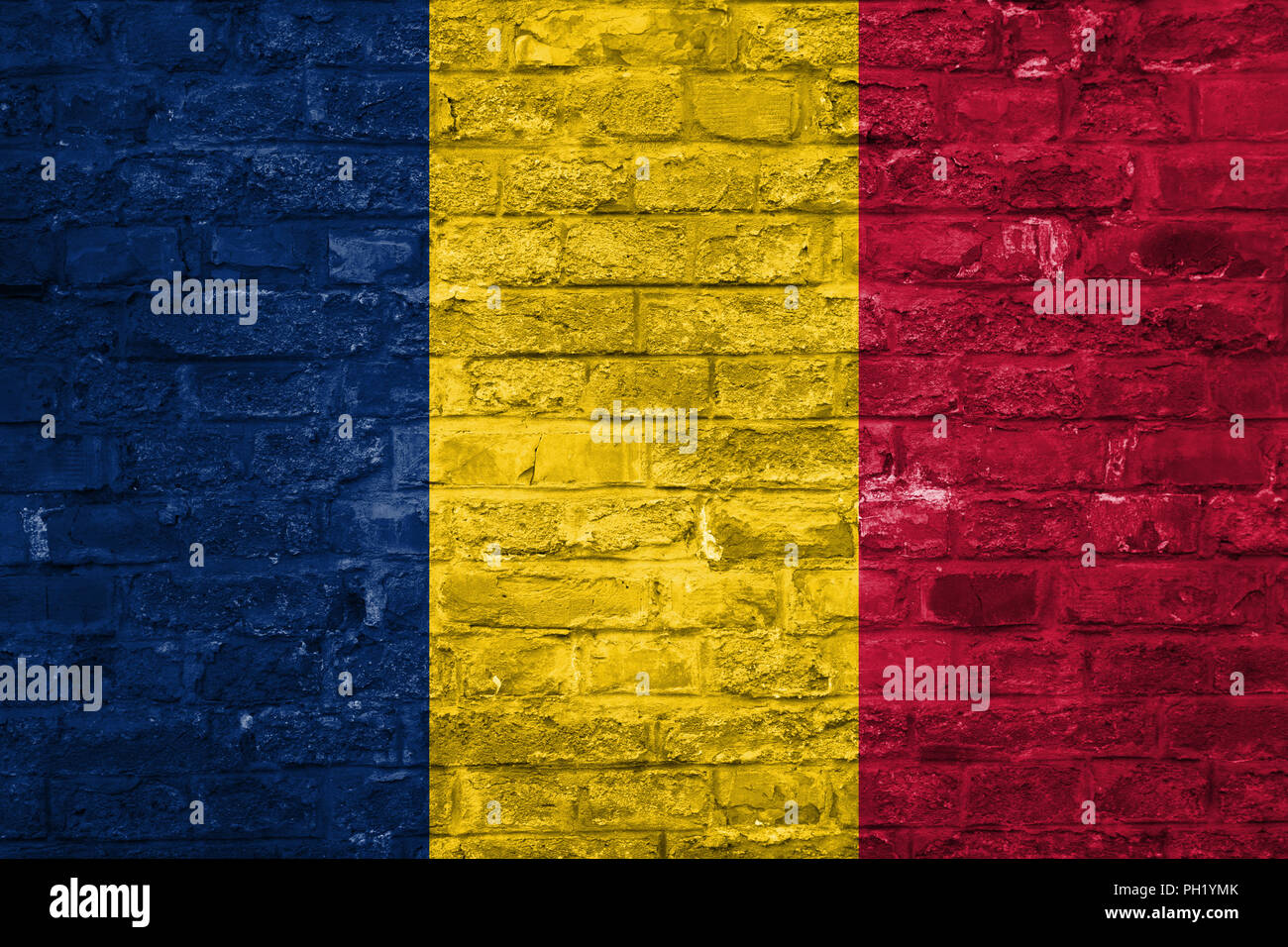 Flag of Chad over an old brick wall background, surface - Stock Image
