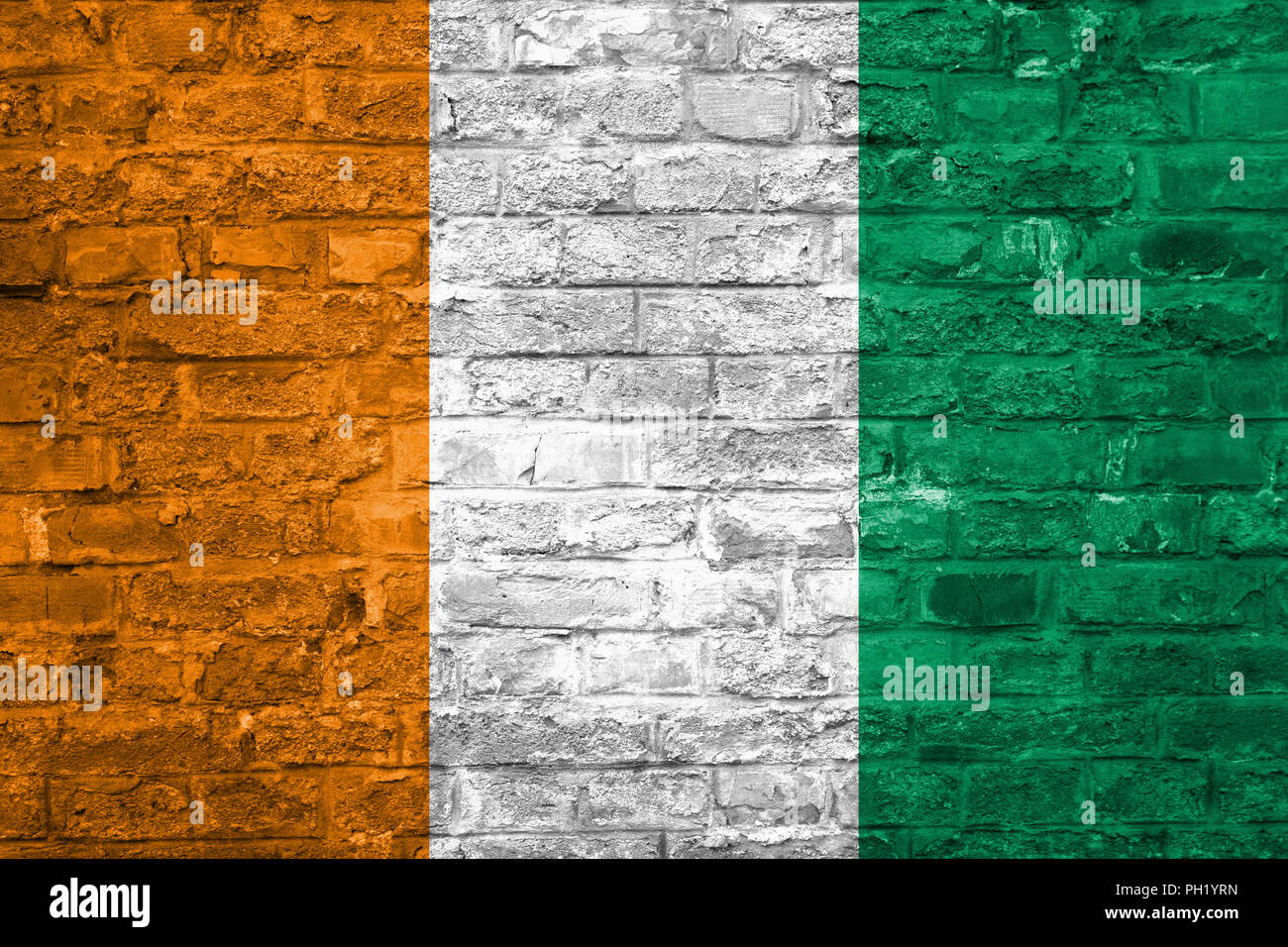 Flag of Cote d'Ivoire over an old brick wall background, surface - Stock Image