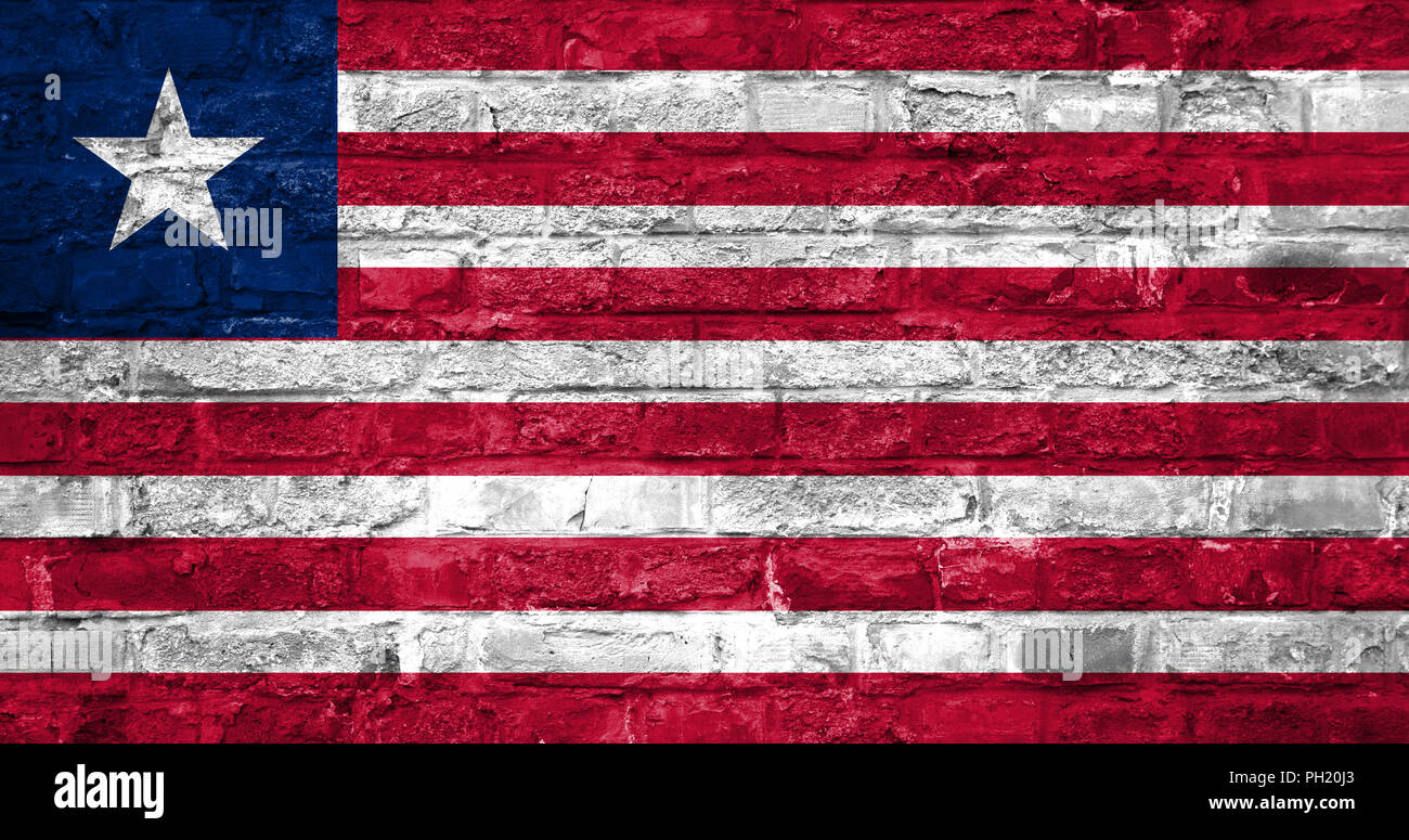 Flag of Liberia over an old brick wall background, surface - Stock Image
