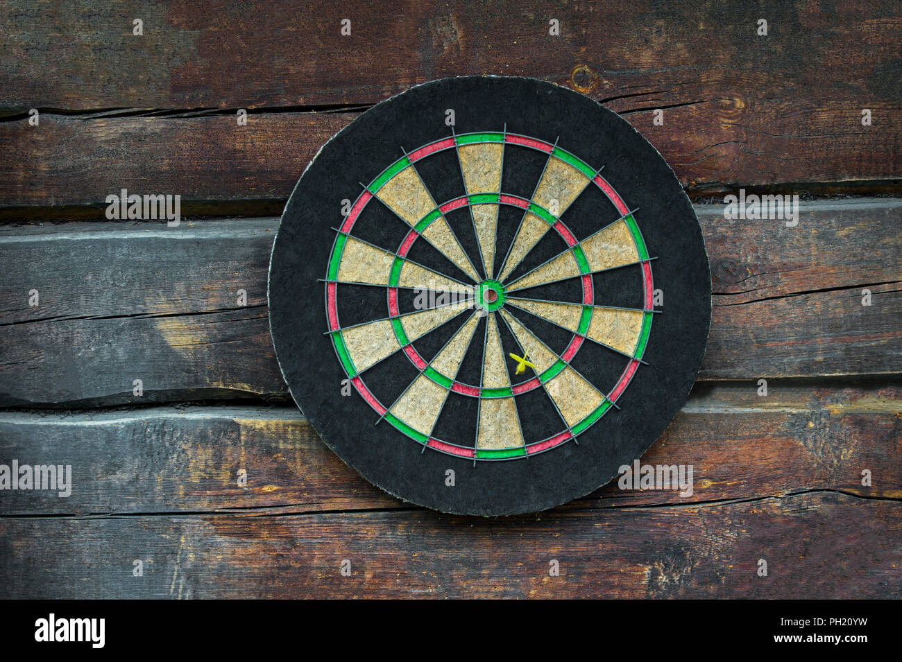 Dart board on old wooden table. Business concept. Stock Photo