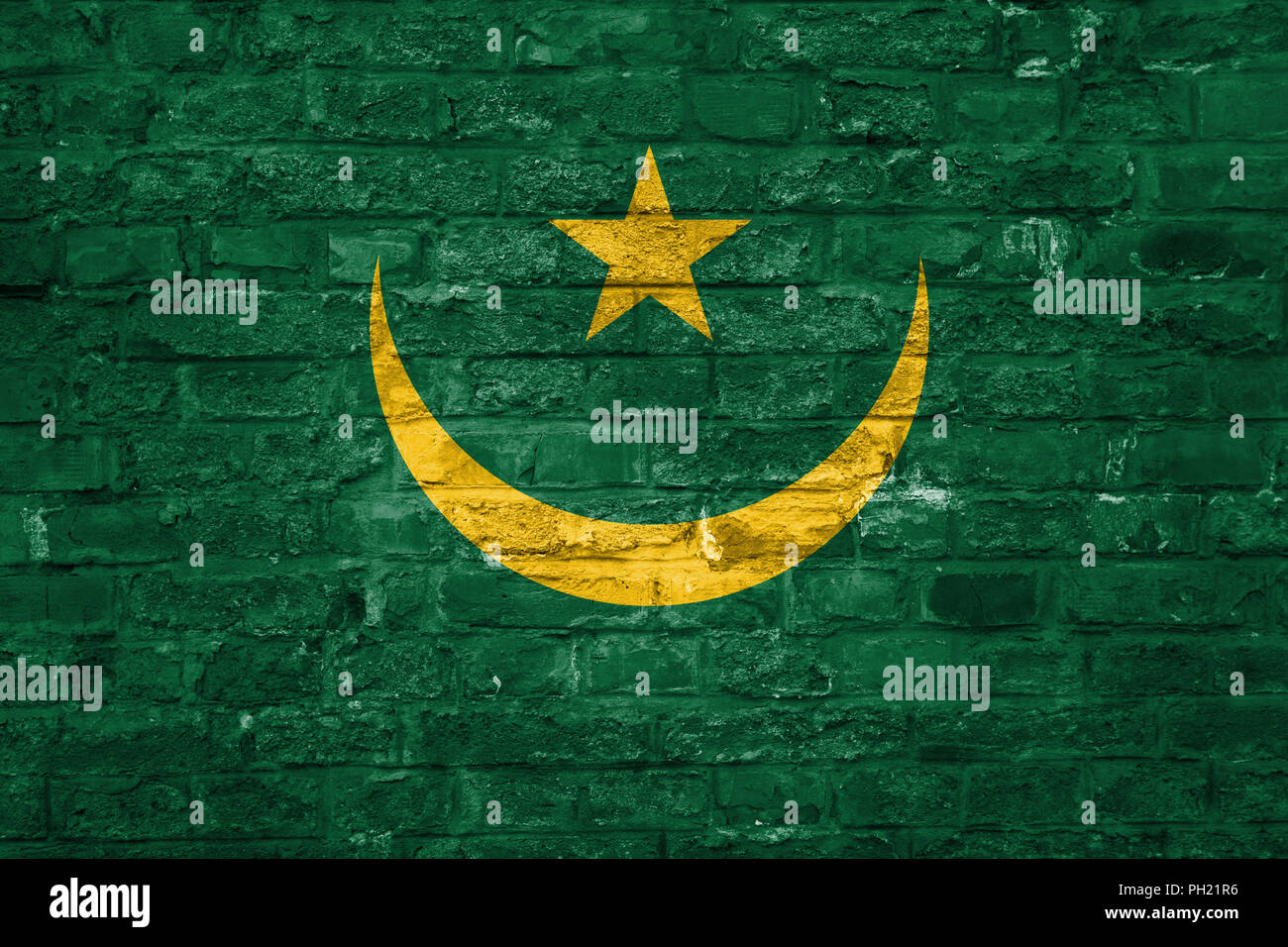 Flag of Mauritania over an old brick wall background, surface - Stock Image