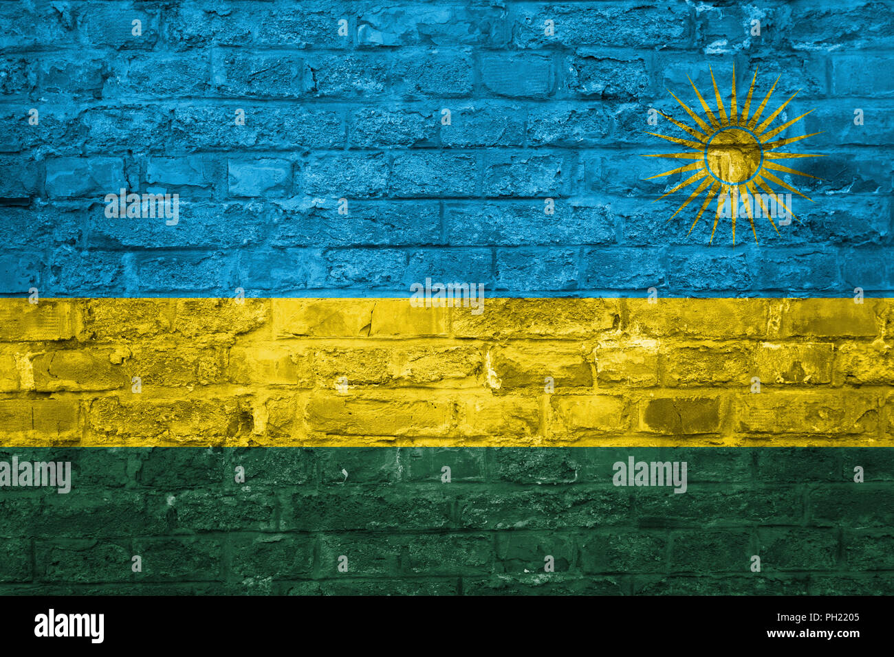 Flag of Rwanda over an old brick wall background, surface - Stock Image