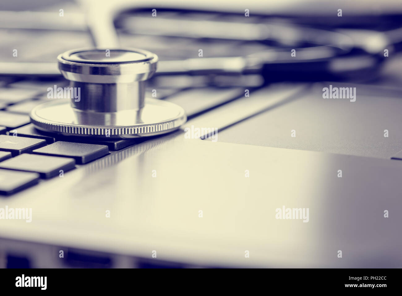 Closeup View Of A Stethoscope Lying On Laptop Keyboard Depicting Online Healthcare And Medical Advice Retro Effect Faded Look