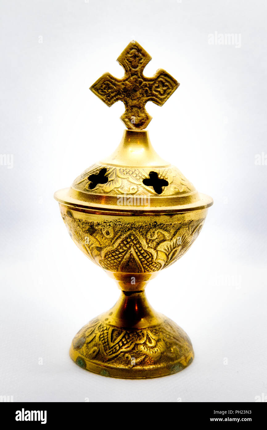 Brass religious Incense burner with cross, crucifix - Stock Image
