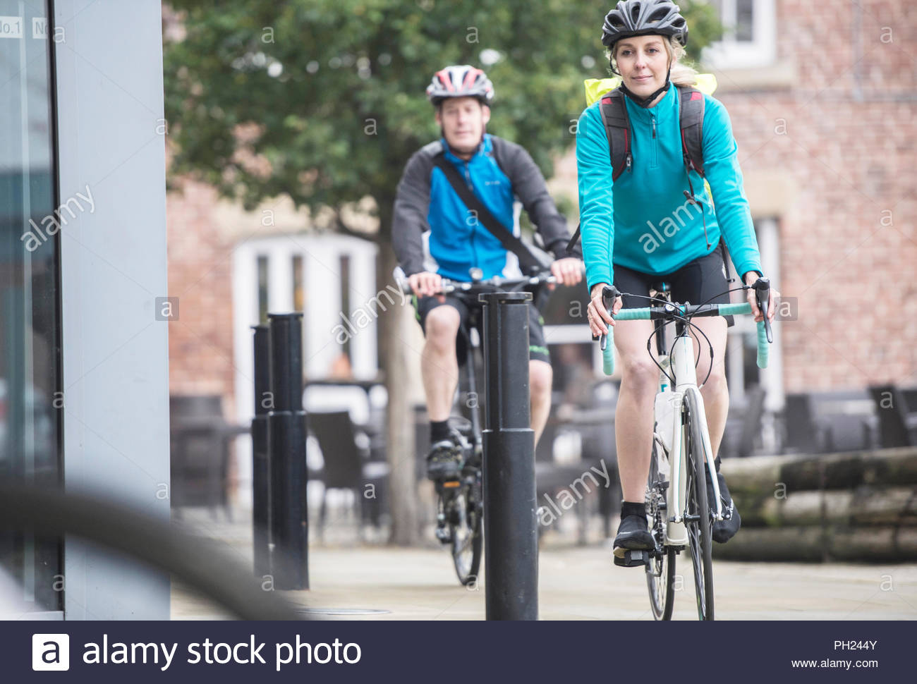 Colleagues arriving at work after commuting by bicycle - Stock Image