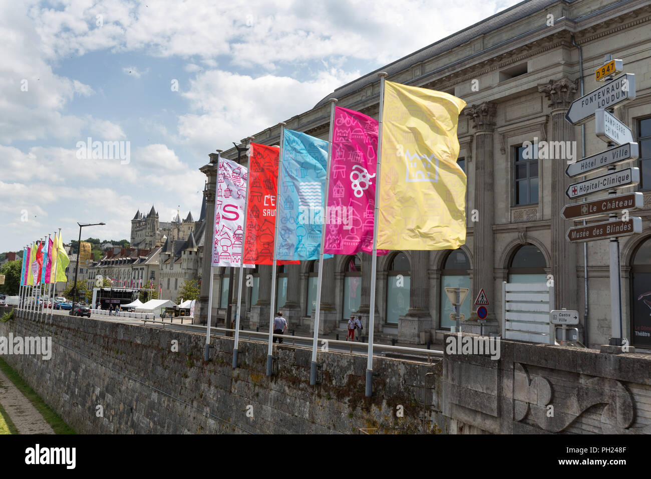 Town of Saumur, France. Picturesque view of banners flying outside the Expo Artistes Saumurois (The Dome) at Saumur's Route de Saumur. - Stock Image