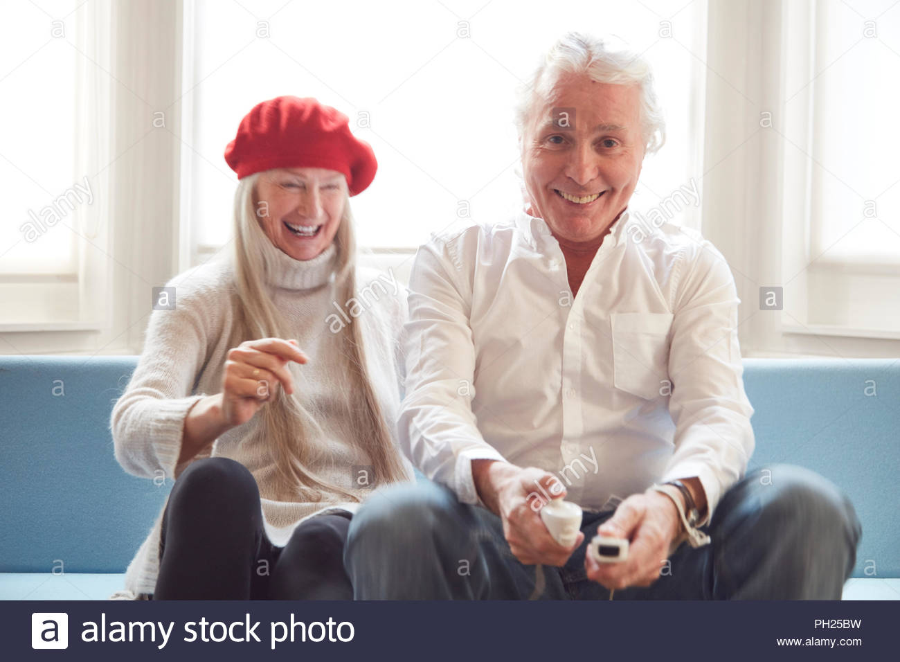 Senior couple playing video games - Stock Image