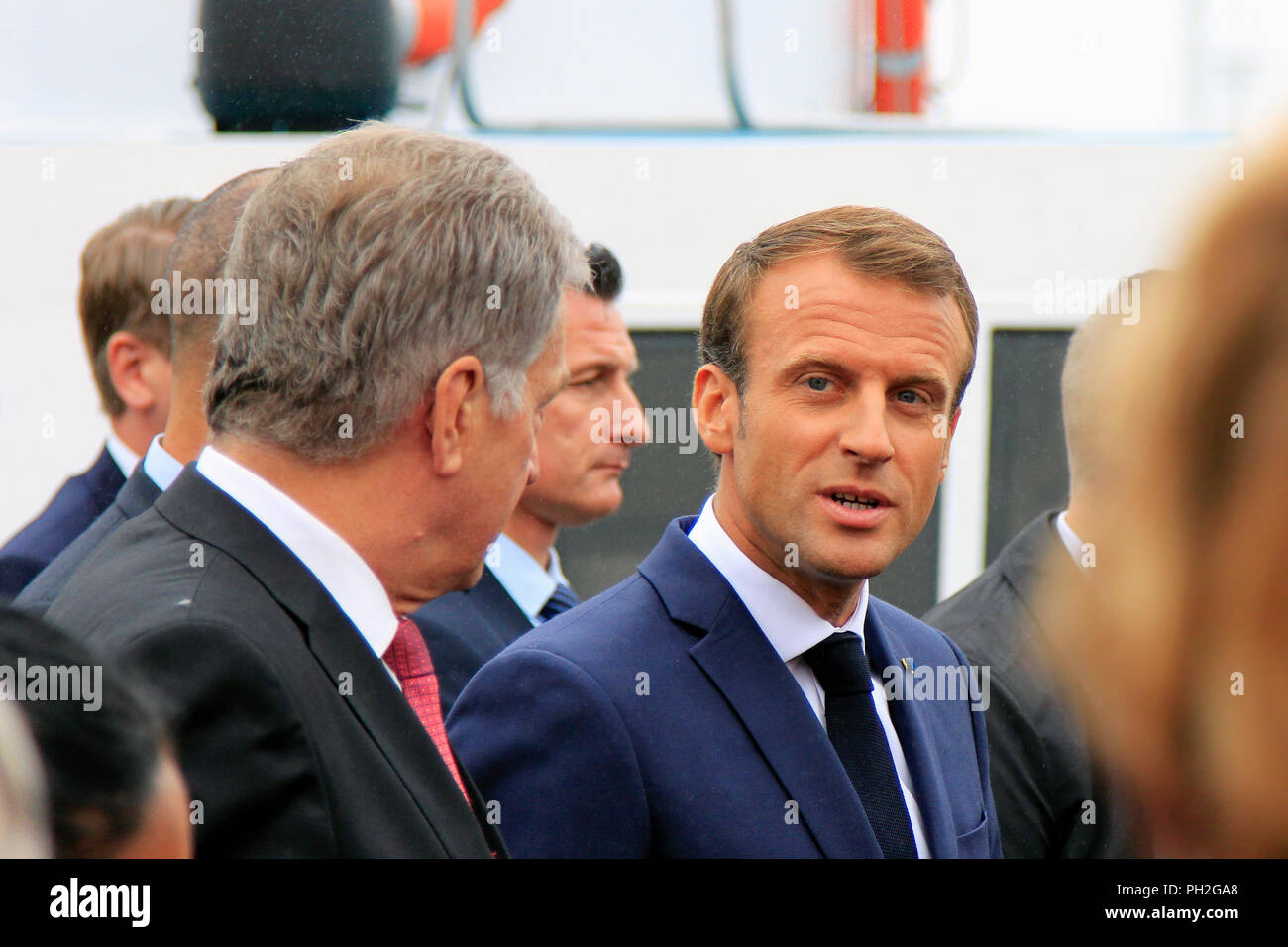Helsinki, Finland. August 30, 2018. Finnish President Sauli Niinistö (L) and French President Emmanuel Macron (R) take a walk on the Market Square after their joint press conference. Credit: Taina Sohlman/Alamy Live News - Stock Image