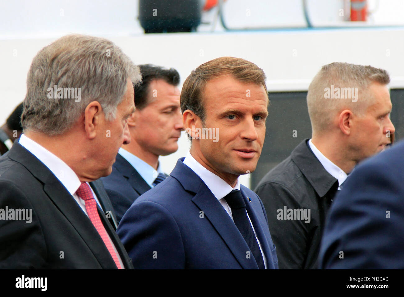 Helsinki, Finland. August 30, 2018. Finnish President Sauli Niinistö (L) and French President Emmanuel Macron (C) take a walk on the Market Square after their joint press conference. Credit: Taina Sohlman/Alamy Live News - Stock Image