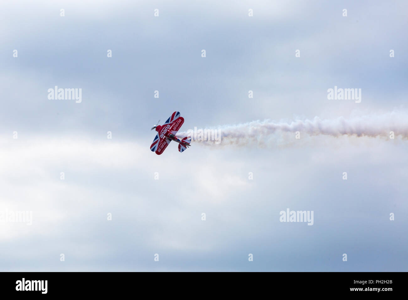 Bournemouth, UK. 30th August 2018. Up to a million people are set to descend on Bournemouth over the next four days as the 11th annual Bournemouth Air Festival gets underway. Lovely sunny day for the start of the festival.  A first for Bournemouth Air Festival, pilot Rich Goodwin showcases the Muscle Biplane Pitts SaS G-EWIZ combining aerial manoeuvres and high energy muscle biplane aerobatics - a special treat in the morning for the opening, ahead of the advertised schedule for the afternoon flying. Credit: Carolyn Jenkins/Alamy Live News - Stock Image