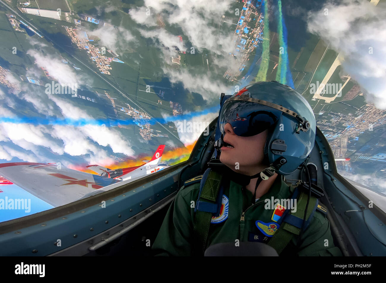 Changchun, China's Jilin Province. 30th Aug, 2018. A pilot of Red Falcon Air Demonstration Team performs during an activity of opening day at the Aviation University of Air Forces in Changchun, capital of northeast China's Jilin Province, Aug. 30, 2018. Credit: Yang Pan/Xinhua/Alamy Live News - Stock Image