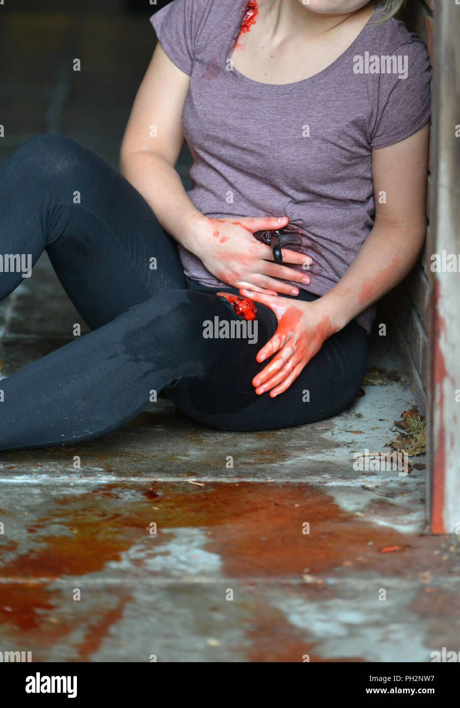Mock-up of a stab victim in a doorway - Stock Image