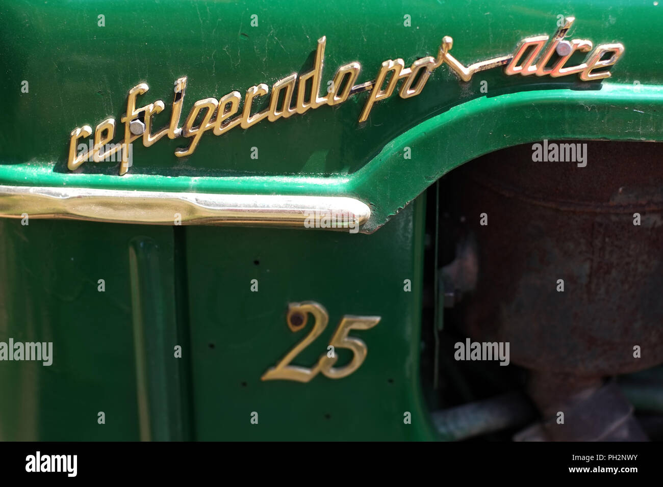 Detail of an air cooled Spanish green tractor - Stock Image