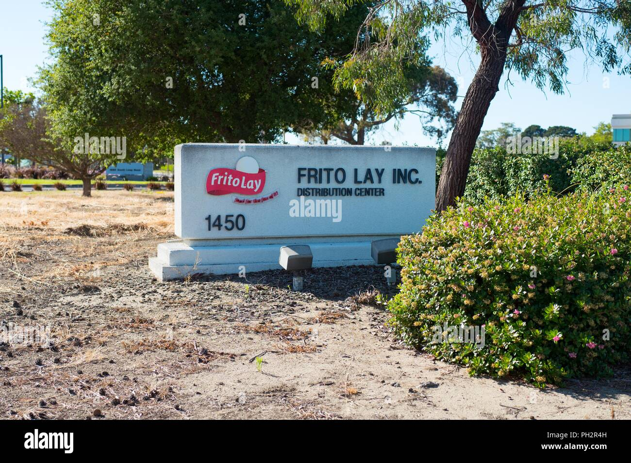 Sign with logo at entrance to Frito Lay Inc snack food distribution center on Bay Farm Island, Alameda, California, July 9, 2018. () - Stock Image