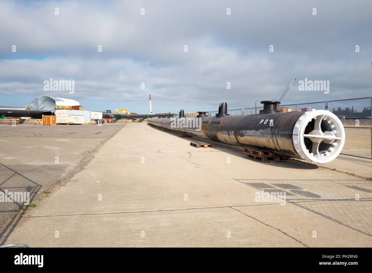 Ocean Cleanup's System 001 under assembly on Alameda Island, Alameda, California, part of a prototype technology to clean up the Great Pacific Garbage Patch, August 13, 2018. () - Stock Image