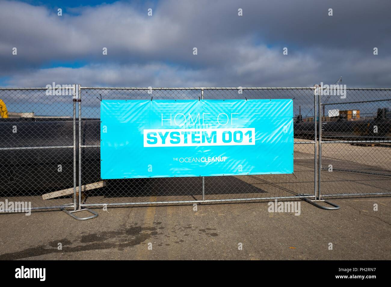Sign on construction site at the assembly site of Ocean Cleanup's System 001, a technology designed to clean up the Great Pacific Garbage Patch, on Alameda Island, Alameda, California, August 13, 2018. () - Stock Image