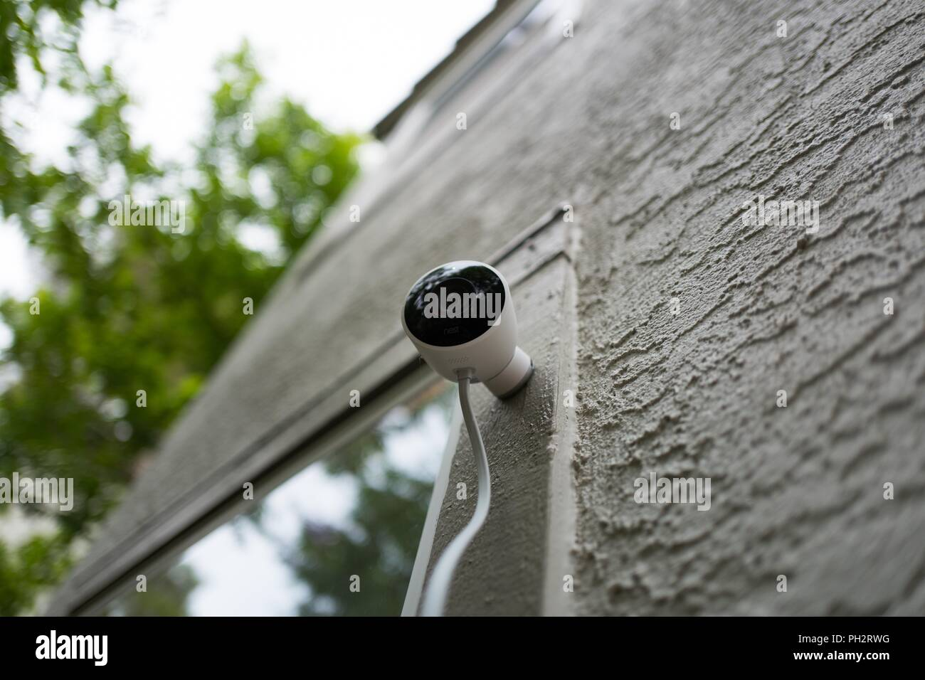Low-angle view of weatherproof outdoor Nest home surveillance camera from Google Inc installed in a smart home in San Ramon, California, August 21, 2018. () - Stock Image