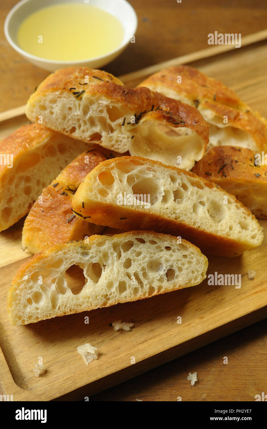 Tasty homemade Focaccia bread with herbs and olive oil - Stock Image