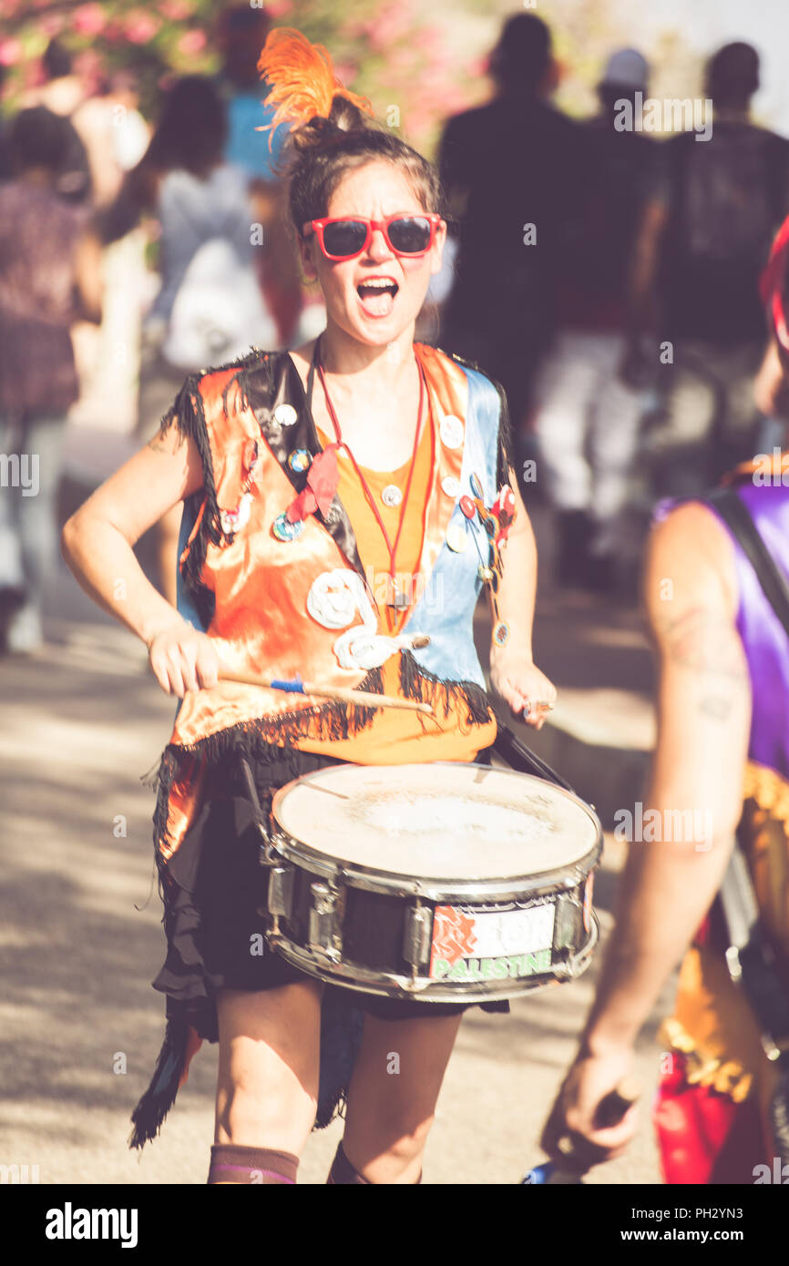 Ventimiglia, Italy, 14.07.2018: Girl playing the drums during a town festival of Ventimiglia in Liguria - Stock Image