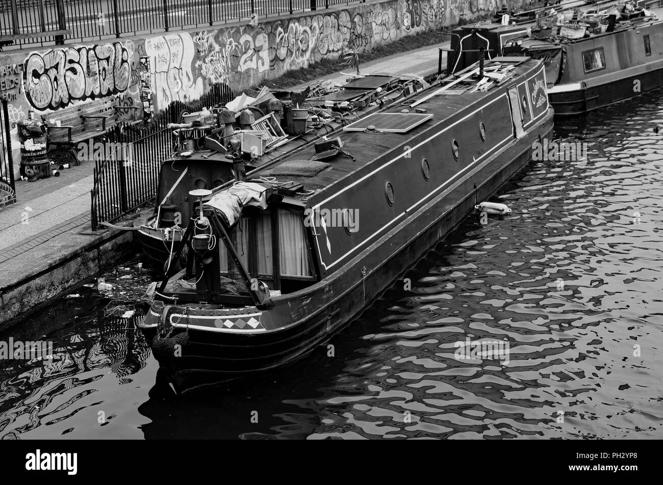 Canal boat moored by towpath on Regents Canal at Haggerston East London - Stock Image