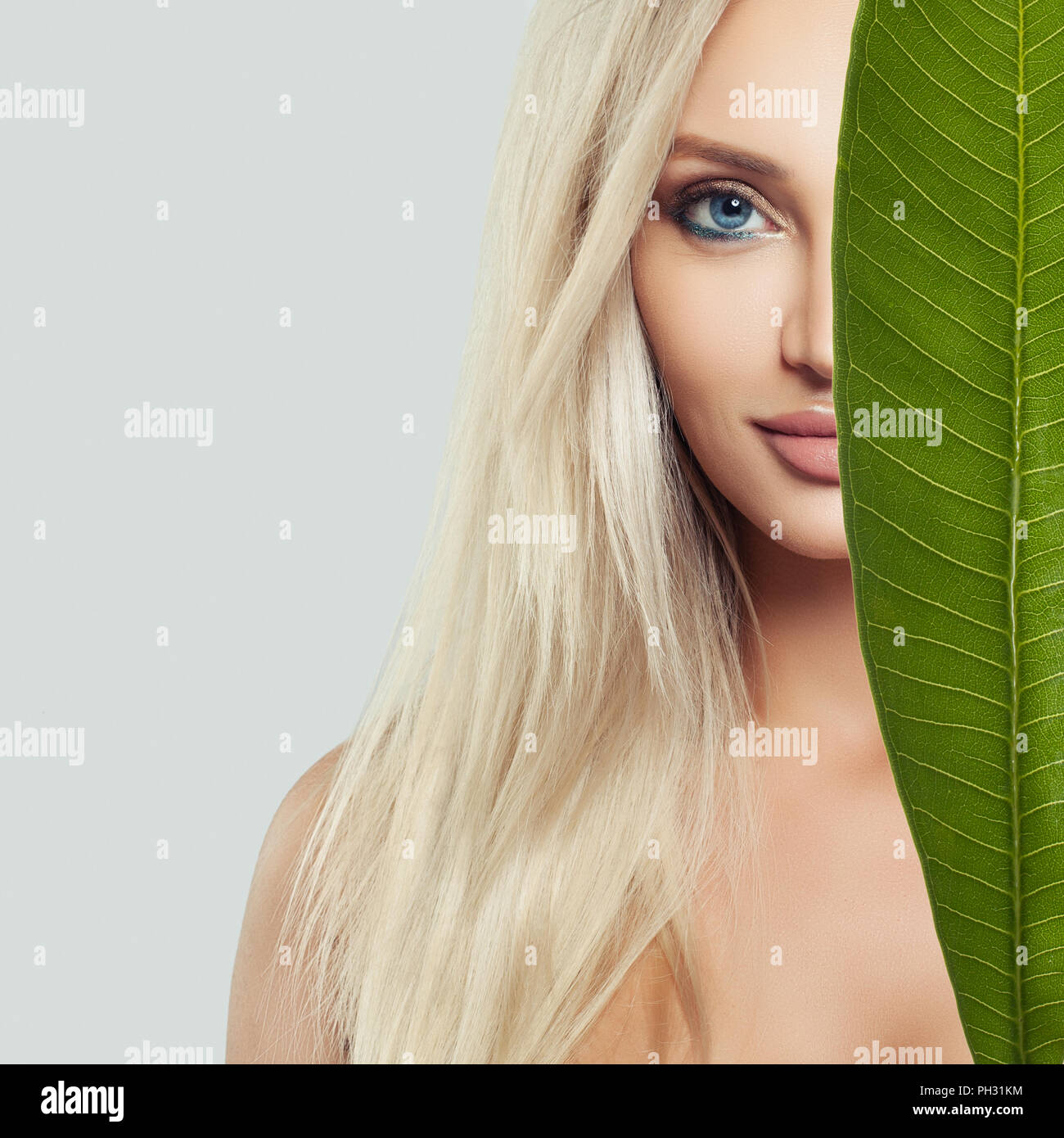 Young Perfect Female Face Beautiful Blonde Woman With Healthy Skin And Green Leaf Natural Beauty Stock Photo Alamy