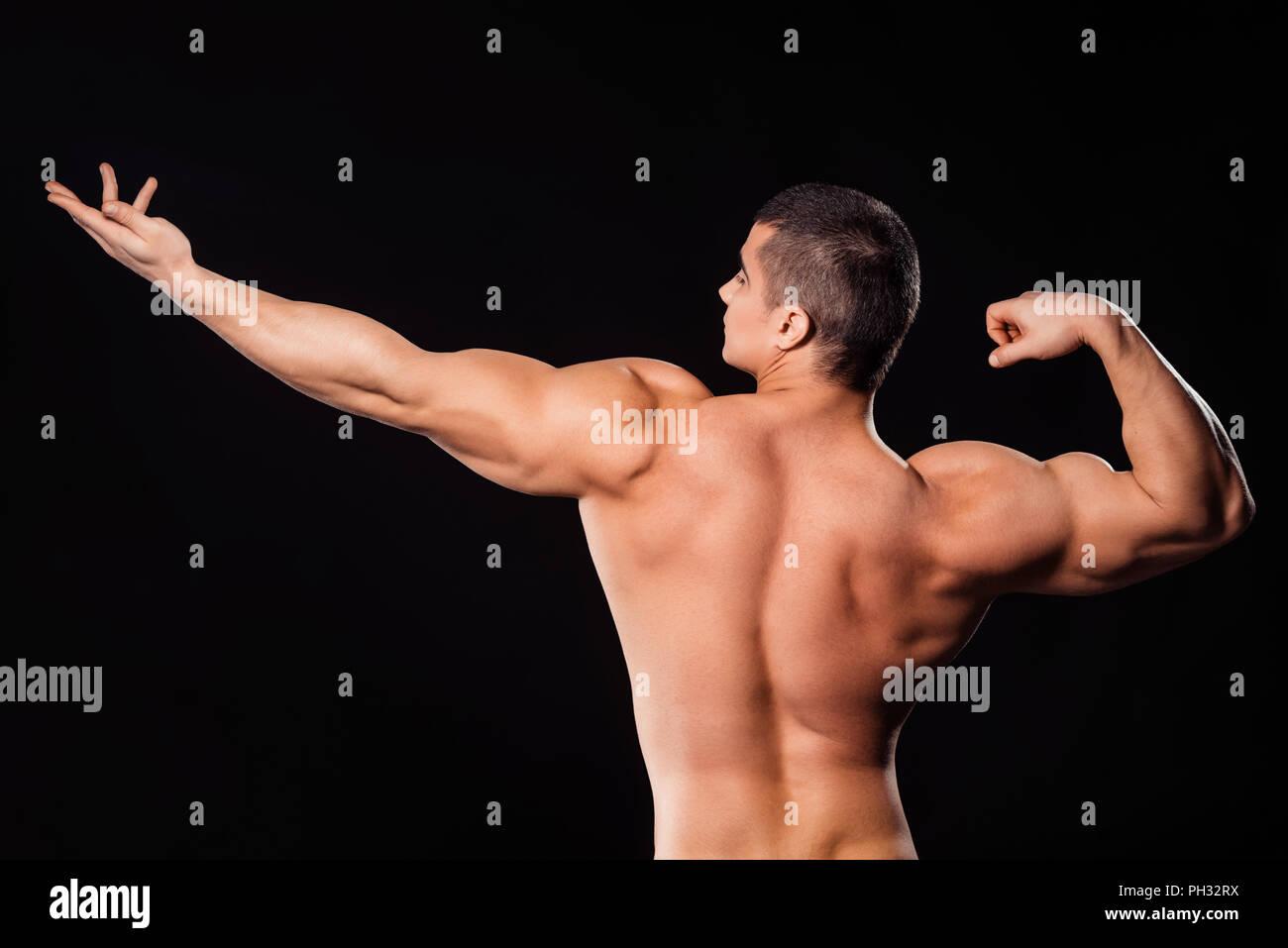 Bodybuilder in archer pose. - Stock Image
