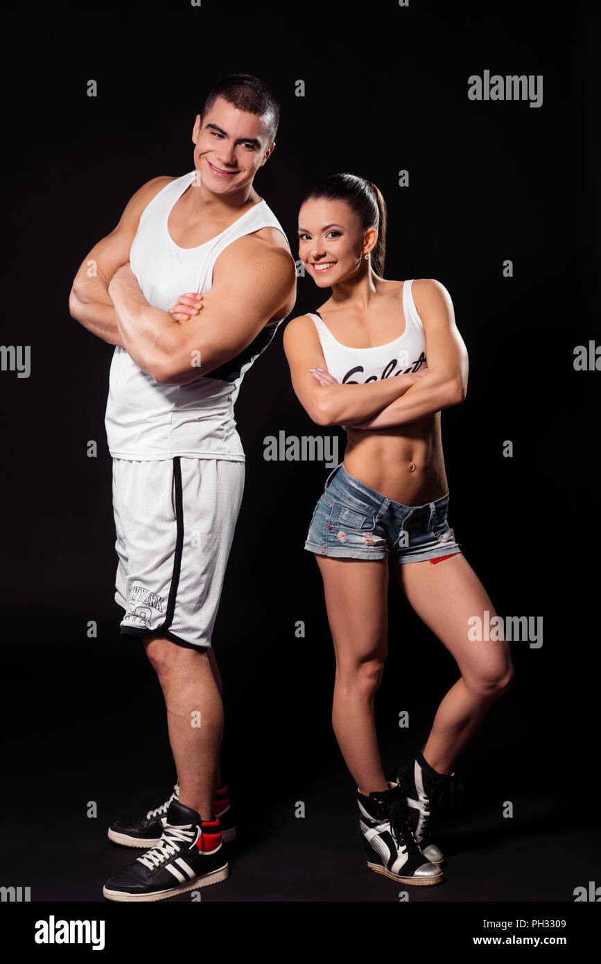 Bodybuilder and woman smiling happily.  - Stock Image