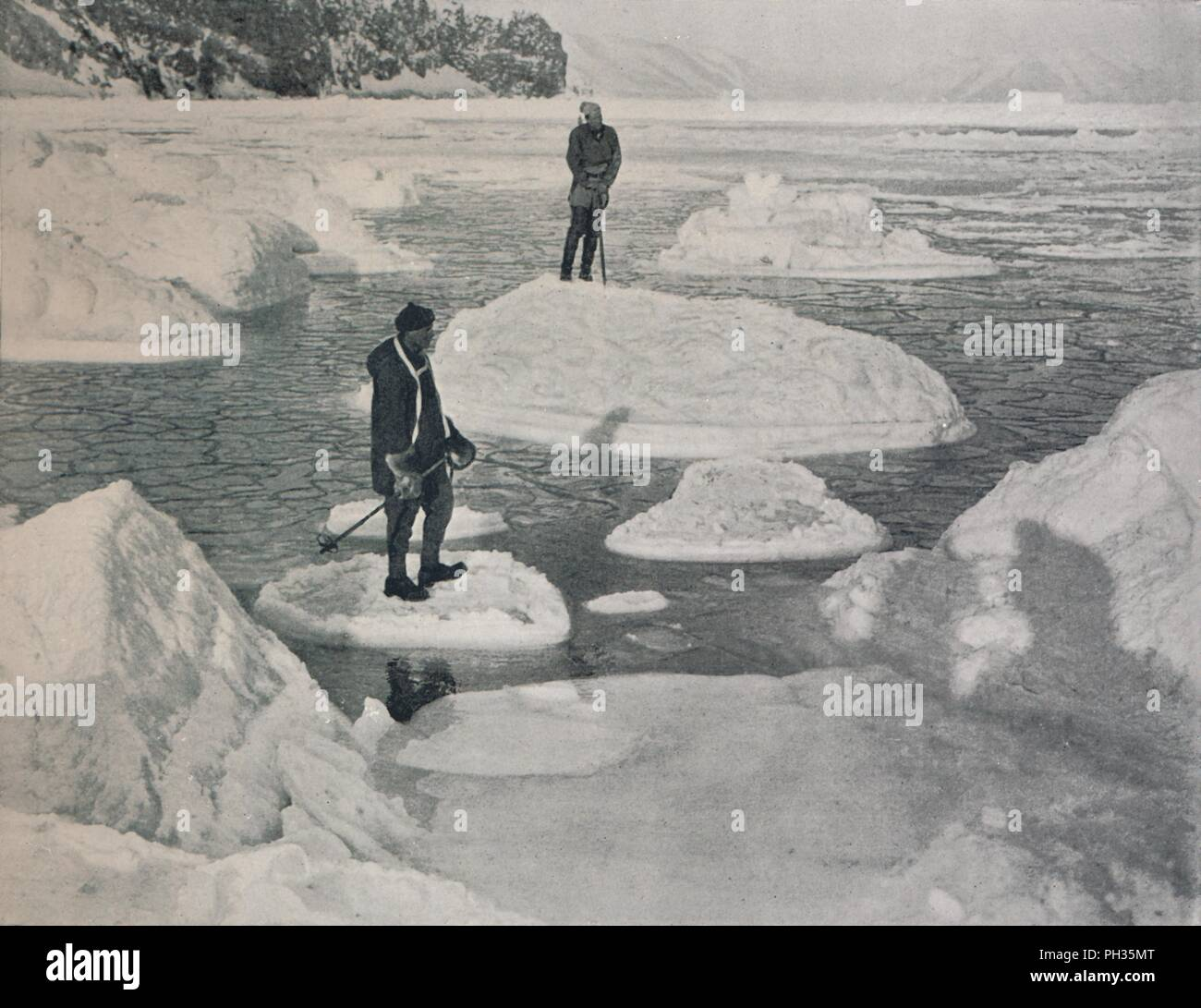 'Campbell and Priestley Afloat on Pancake Ice', 1912, (1913). Expedition members Lieutenant Victor Campbell and geologist Raymond Priestley. The final expedition of British Antarctic explorer Captain Robert Falcon Scott (1868-1912) left London on 1 June 1910 bound for the South Pole. The Terra Nova Expedition, officially the British Antarctic Expedition (1910-1913), included a geologist, a zoologist, a surgeon, a photographer, an engineer, a ski expert, a meteorologist and a physicist among others. Scott wished to continue the scientific work that he had begun when leading the Discovery Expedi - Stock Image