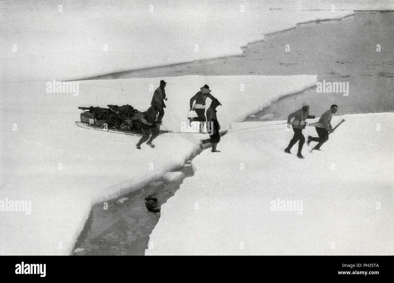 'The Relief of the Western Party by the 'Terra Nova' Off the Mouth of the Koettlitz Glacier', 18 February 2012, (1913). T Griffith Taylor, Frank Debenham, Tryggve Gran and Robert Forde, members of the second geological expedition, were due to be picked up by Terra Nova on 15 January 1912, but the ship could not reach them until over a month later. The final expedition of British Antarctic explorer Captain Robert Falcon Scott (1868-1912) left London on 1 June 1910 bound for the South Pole. The Terra Nova Expedition, officially the British Antarctic Expedition (1910-1913), included a geologist,  - Stock Image